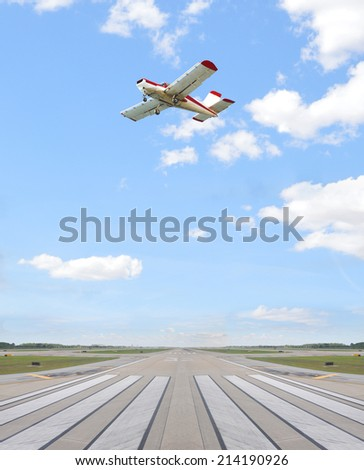Airplane Flying over Airport Runway