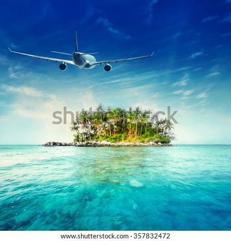 Airplane flying over amazing ocean landscape with tropical island. Thailand travel destinations   - stock photo