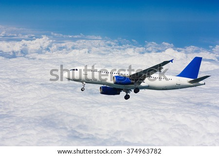 Airplane flying over cloudy sky. Passenger aircraft. - stock photo