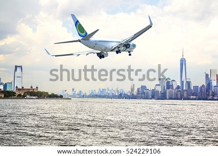Airplane flying over  New York City.