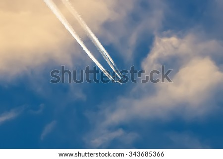 Airplane flying over the city at high altitude. - stock photo