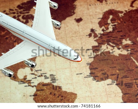 Airplane flying over the world map - stock photo