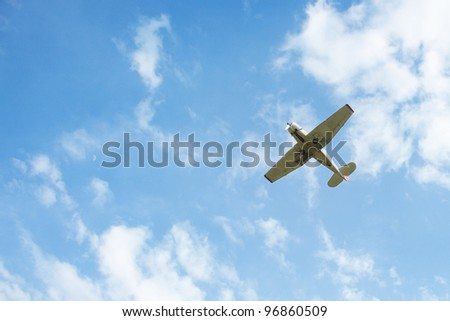 Airplane flys in the cloudy sky. Natural light and colors - stock photo
