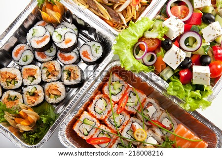 Airplane Food - Sushi, Greek Salad and Spaghetti - stock photo