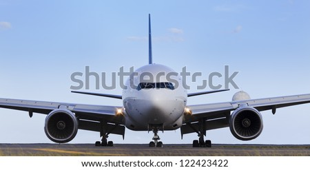 airplane front close-up view airfield ground day time blue sky clear background - stock photo