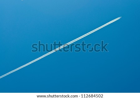 Airplane in bleu sky - stock photo