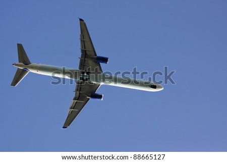 Airplane in flight from below