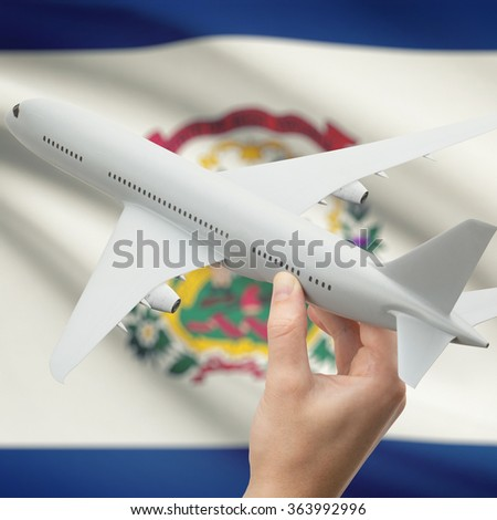 Airplane in hand with local US state flag on background series - West Virginia - stock photo