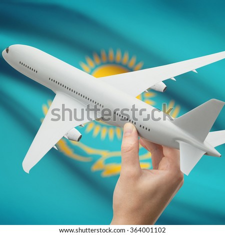 Airplane in hand with national flag on background series - Kazakhstan - stock photo