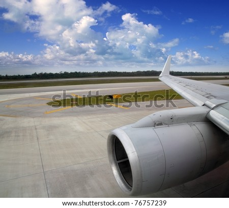 airplane in landing runway road plane wing blue sky - stock photo