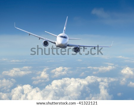 Airplane in the cloudy sky - stock photo