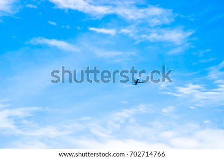 Airplane in the cloudy sky. Travel concept
