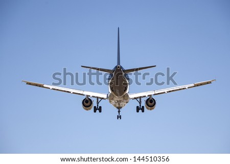 Airplane in the sky, Airbus A340 - stock photo