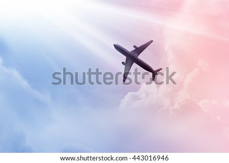 Airplane in the sky and cloud colorful at sunset - stock photo