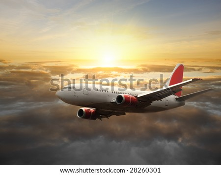 Airplane in the sky at sunset  - Passenger Airliner / aircraft - stock photo