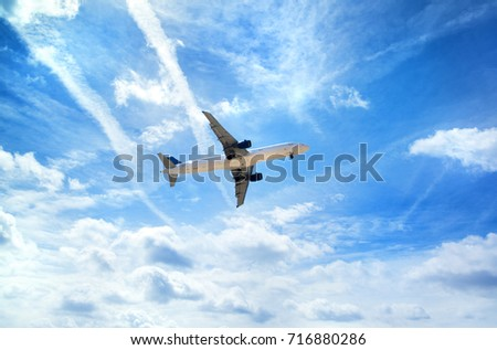 Airplane in the sky. Travel concept image. London