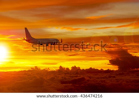 Airplane in the sky with the sunrise prepare to landing to the airport