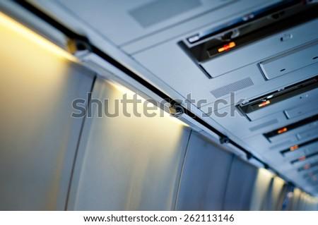 Airplane interior detail. No smoking sign. - stock photo