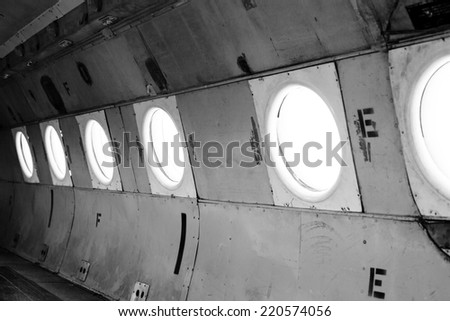 Airplane interior with seats closeup photo - stock photo