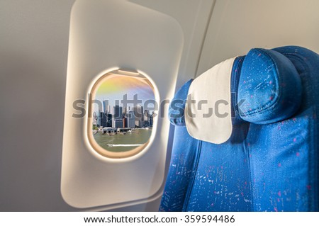 Airplane interior with view on New York City. Tourism and travel concept. - stock photo
