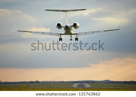 Airplane is landing on the airport - stock photo