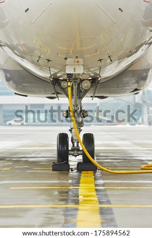 Airplane is parking at the airport. - stock photo