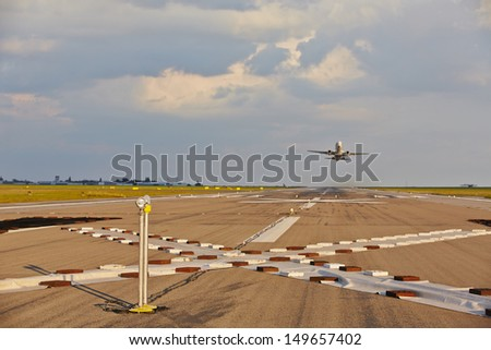 Airplane is taking off from the airport  - stock photo