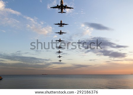 airplane landing approach time lapse - stock photo