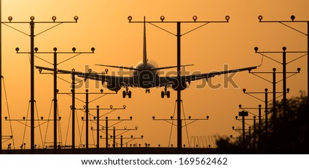 Airplane landing at Los Angeles International Airport during sunset, Los Angeles, California, USA