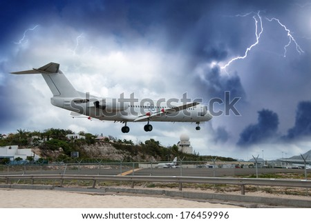 Airplane landing in the storm.