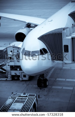 Airplane Loading At The Airport And Loading Cargo
