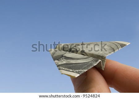 Airplane made from dollar banknote - stock photo