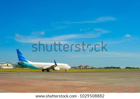 Airplane on a runway during a takeoff at Bali island airport, Indoneisa