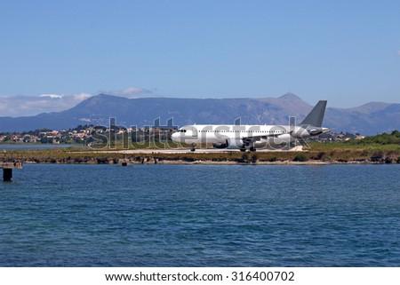 airplane on airport Corfu island Greece - stock photo