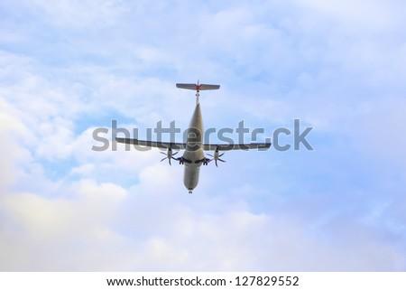 Airplane on blue sky - stock photo
