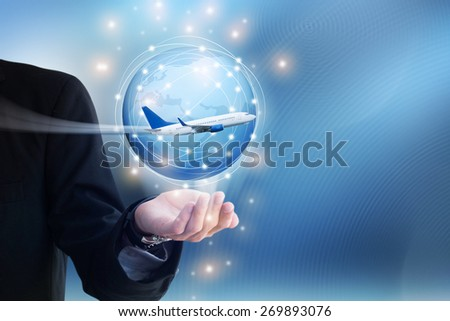 Airplane on hand with World Map and Globe icon - stock photo