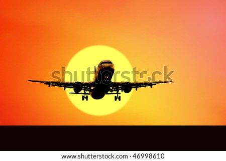 Airplane on sunset sky - stock photo