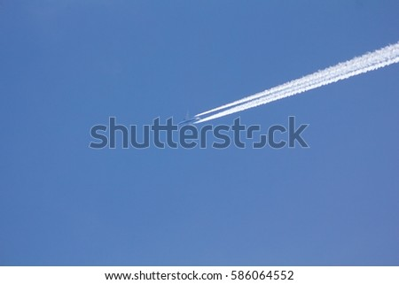 Airplane on the blue sky.