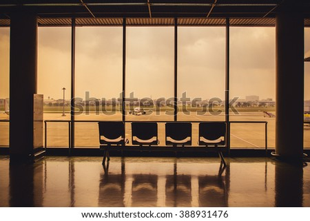 airplane outside a window in the airport terminal - stock photo