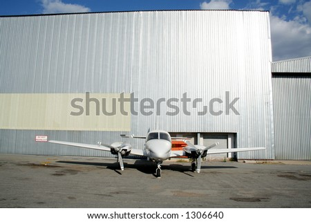 Airplane outside hanger - stock photo
