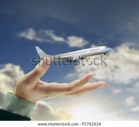 airplane over his hand - stock photo