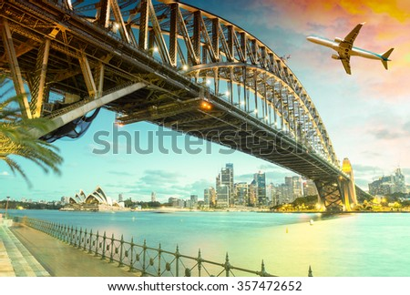 Airplane over Sydney Harbour Bridge. Holiday concept.