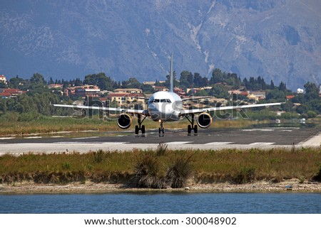 airplane prepares for takeoff Corfu island - stock photo