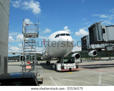 Airplane ready for boarding - stock photo