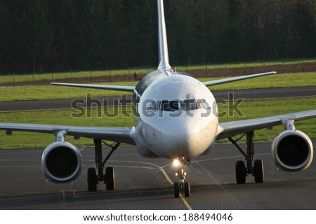 Airplane safe on the ground - stock photo