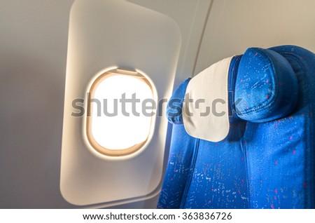 Airplane seat with white empty window. - stock photo