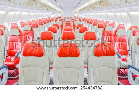 airplane seats in an airplane cabin - stock photo