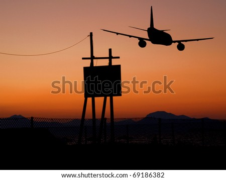 Airplane silhouette in sunset - stock photo