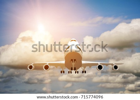 Airplane take off on the blue sky, big jet plane flying on blue cloudy skybackground