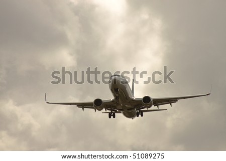 airplane take off with a cloudy sky background
